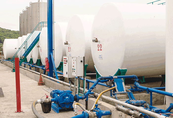 OLVEA Group uses large storage tanks to house the oil prior to transferring it to 330-gallon IBCs and 50-gallon drums