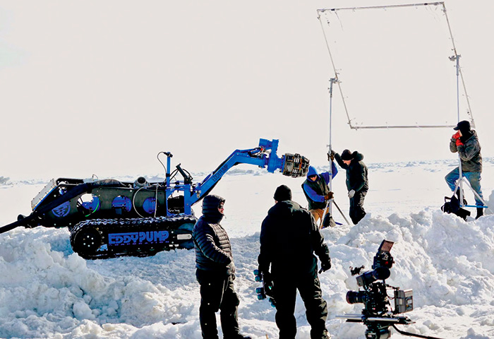 Image 1. A Discovery Channel camera crew records video of the remote-operated submersible dredge used for gold mining in Alaska. (Images courtesy of Eddy Pump)
