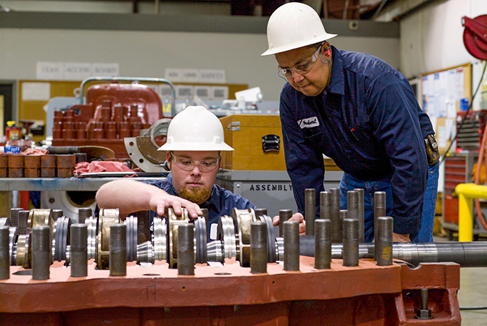 workers fixing impeller