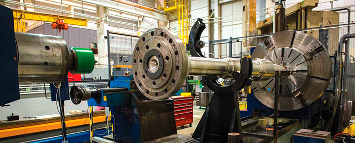 The RCP shaft is placed in the lathe to measure total indicated runouts (TIR).