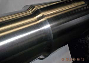 A newly manufactured shaft with the proper radius.