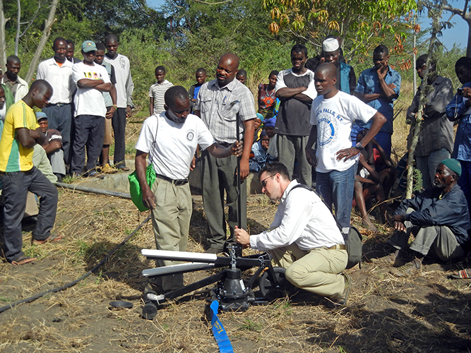 Farmers test the Saajhi Stepping Pump.