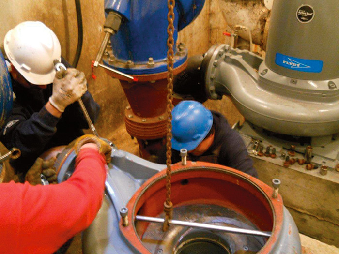 Workers place and secure the volute before the remainder of the pump is received.