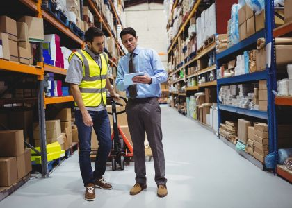 Manager and worker in a warehouse