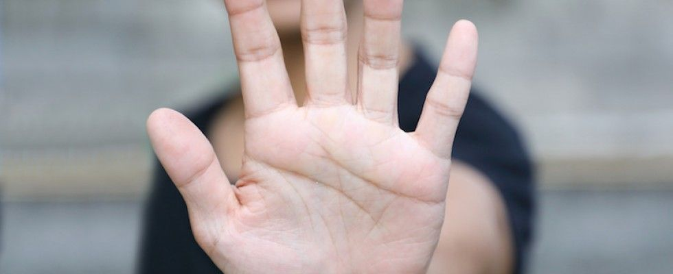 image of hand in stop stance