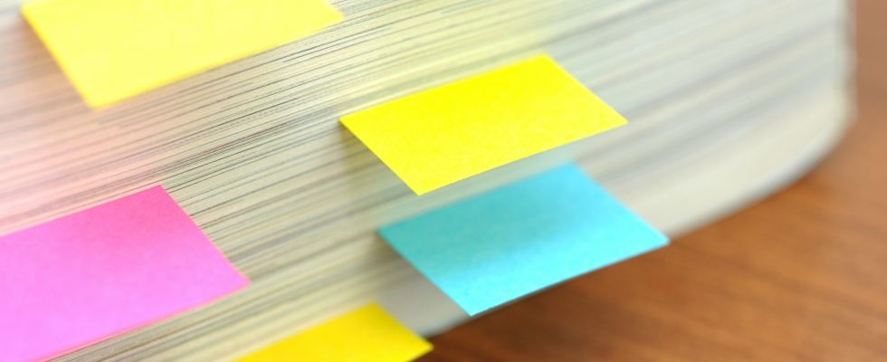 pile of paper with post-it notes