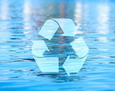 Recycyling symbol over water background