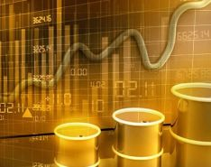 Photo of stock prices climbing and falling with barrels of oil in the foreground.