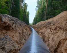 natural gas pipeline going through forest setting